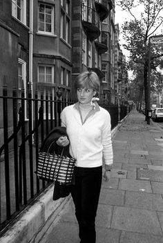 November 11, 1980 - Diana was photographed outside of her apartment constantly. Here she is leaving her apartment for work. Some photographers even rented the flat across the street to get more photos.