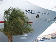 Carnival Valor docked in port.  First cruise ship