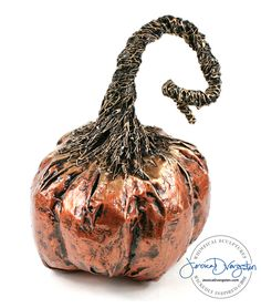 Paper mache gold and copper pumpkin by sculpture artist Jessica Dvergsten for Halloween.