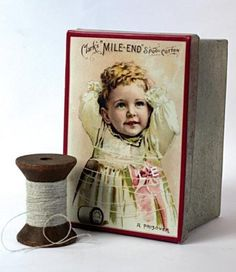 """Button Tin    A lovely old advertisement graces the lid of a decorative tin ideally suited for needles, thread, buttons and small mending needs. 5 x 3"""""""
