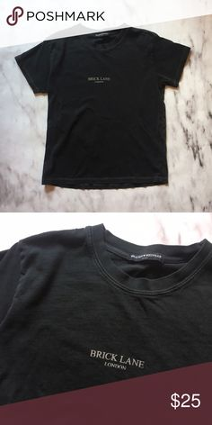 """brandy melville brick lane t shirt rare brandy melville t shirt made of soft black cotton with """"brick lane london"""" printed on the front. there is contrast stitching along the sleeves, neck and hem. worn once and in perfect condition Brandy Melville Tops Tees - Short Sleeve"""