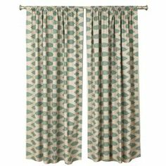 """Cotton curtain with a trellis motif. Made in the USA.      Product: Set of 2 curtain panelsConstruction Material: CottonColor: Blue and linenFeatures:  2"""" Rod pocket3"""" HemMade in the USA Cleaning and Care: Spot clean"""
