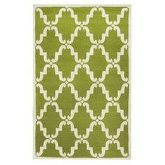 Bring a chic world-traveling spirit to your foyer, living room, or master suite with this lovely wool rug.   Product: RugConstruction Material: 100% WoolColor: GreenFeatures: Hand-tuftedNote: Please be aware that actual colors may vary from those shown on your screen. Accent rugs may also not show the entire pattern that the corresponding area rugs have.Cleaning and Care: Spot treat with a mild detergent and water.  Professional cleaning is recommended if necessary.