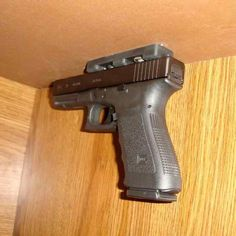 Glock with magnet holder...  my next project...  not until the kids are gone and locks are changed of course...