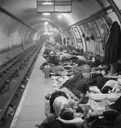 Civilians sheltering in Elephant and Castle London Underground Station during an air raid in November 1940. — a document to bring aside Henry Moore's stunning drawings of underground shelters in the period.
