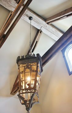 An impressive ceiling with beams from an old tobacco barn deserves an impressive chandelier.