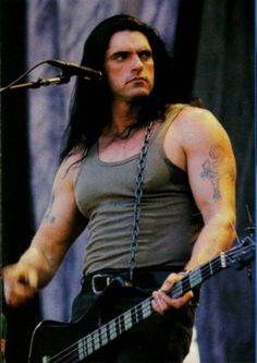 Peter Steele - I mean...really. I got to meet him and hang out for a few mins. Got a photo of him with his HUGE hand palming my head. He was an ENORMOUS man. So tall that it was hard to get us both in the same photo!