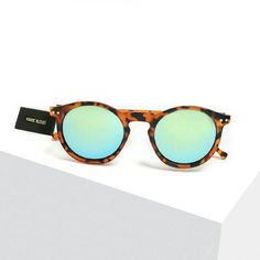 "Tortoiseshell ""cool"" sunnies These green and slightly blue mirror shades have a Chic 50s vintage cut accented by brown tortoise shell looking texture! Cool colored & round shaped lenses really give these sunglasses a unique look // brand new never worn // all photos are of exact sunnies for sale taken by me and not to be shared, thanks! Also 1 available in classic black lens shown in final photo for modeling / scale on face only. FYI these do not fit me, so the final photo IS the modeled…"