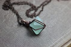 Hey, I found this really awesome Etsy listing at https://www.etsy.com/listing/250515038/caged-green-fluorite-octahedron-necklace