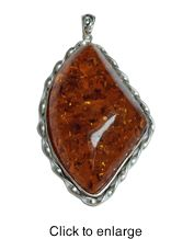 """Siluxe silver tone simulated honey Amber pendant. Designed with a 42x70 mm simulated honey colored Amber stone. Pendant is 1 7/8"""" wide by 2 3/4"""" long. This item is fine silver plated.  Suggested Retail Price: $19.50  Blow Out Wholesale Price: $6.50"""