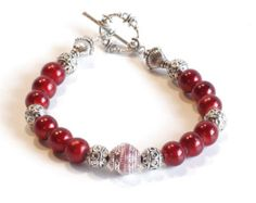 Check out RED Women's stackable bracelet, stacking bracelet, statement bracelet, beaded bracelet on dunglebees