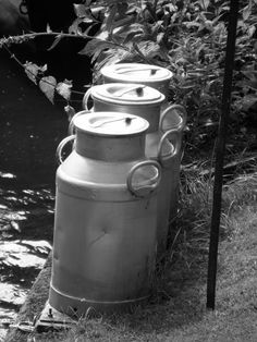 old milk cans...I remember helping my cousin put these at the end of the lane for the milk man to pick up. Ballymena