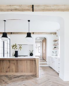 "The Coastal Table on Instagram: ""Exposed beams, chevron hardwood floors, black accents... what else would you want in a kitchen? Photo by @stofferphotographyinteriors"""