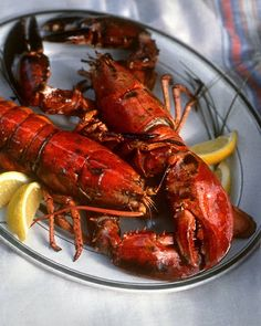 Grilled Lobster    Ingredients    4 live lobsters, 1 to 2 pounds each  Unsalted butter, melted (optional)  Lemon wedges  Directions    Kill lobsters by plunging them headfirst into salted boiling water and cooking for 1 minute. Remove, and drain.  Place lobsters on a medium-hot grill. Cook for 8 to 10 minutes, turning occasionally to avoid burning