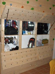 Climbing gear shelf built into bouldering wall.