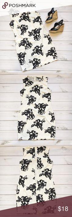 "💥SALE💥 White & Black Floral Print Dress Fifth & Park White and black floral print dress Slight A line Jewel neckline  Zip up back CARE: Machine wash cold, hang dry MATERIALS: 95% polyester, 5% spandex SIZE: Medium  MEASUREMENTS: Approximately 35"" LENGTH (high point shoulder to hem)  18"" BUST (armpit to armpit) Fifth & Park Dresses Mini"