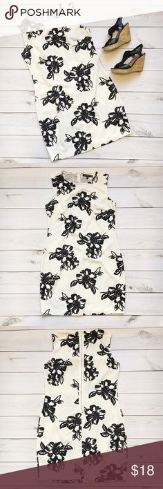 White & Black Floral Print Dress Fifth & Park White and black floral print dress Slight A line Jewel neckline  Zip up back CARE: Machine wash cold, hang dry MATERIALS: 95% polyester, 5% spandex SIZE: Medium  MEASUREMENTS: Will be posted soon! Dresses Mini