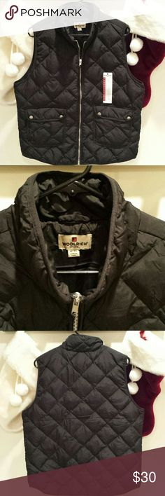 Woolrich black puffy vest XL NWT Zip up black puffy vest with 2 front pockets NWT no defects from a pet and smoke free home. Woolrich Jackets & Coats Vests