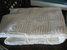 No longer available online with that name, but this Mitered Blanket appears to share identical directions but a slightly different size and gauge as this.