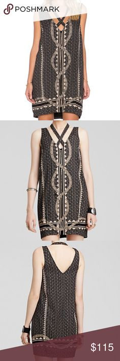 "NWT FREE PEOPLE DIAMONDS & SNAKES MINI DRESS Seed bead embellishments add sparkle to the charming geo print of a sleeveless shift dress. A halter-style strap augments the V-neckline for a cool, layered look. 36"" length (size Medium). 100% cotton-lining. 100% rayon. Hand wash cold, line dry. By Free People; imported. Free People Dresses Mini"