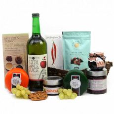 Cheese Delight Hamper A Great Selection Of Cheese Hamper That Can Be Enjoyed Over The Festive Season And Perfect To Send As A Traditional Christmas Gift To Friends And Family. Beautifully Presented In A Wicker Basket Filled With A Variety Of Delectable Nibble Treats Of Crackers, Nuts, Gourmet Cheese Slection And James Whites Apple Juice Drink Making It A Fine Afternoon Treat.