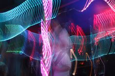 Long exposure light painting of bass player Bob See at the Club KasBar