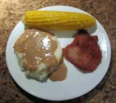 Home cooking is lot about basic resources.  Ear corn with butter and light salt. Real mashed potatoes and real pork gravy made from the breaded and pan fried pork chop.  A simple pleasures meal.