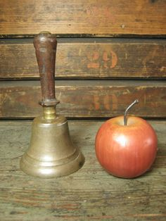 Sweet Old Small Sized One Room School House Bell from hannahshouseantiques on Ruby Lane - I have my grandmothers and used it on my kids to wake up -