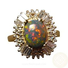 A Black Opal Ring for women who love Big Opal Rings or want some bling on their finger. A natural Black Opal takes center stage and is surrounded by quality Round and Baguette Diamonds. Available in any Ring Size and Gold Color preference. http://www.flashopal.com/Black-Opal-Ring-Multi-Diamonds-Red-Blue-Oval-Stone/