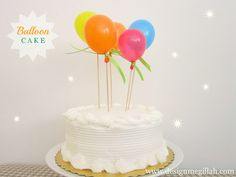 cake decorating idea: use balloons instead of candles, especially on windy days, via Design Megillah