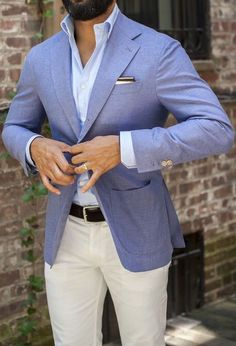 Light Blue / Pastel Blue Blazer . Light Blue Shirt . White / Black Pocket Square . Black Belt . White / Ivory / Light Beige Chinos
