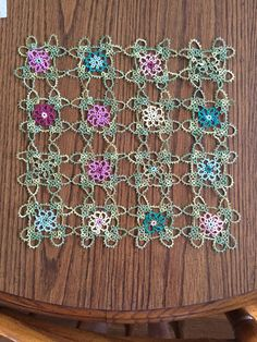 I recently found a set of Bone China at an antique shop in Licoln City, OR that I fell in love with. I wanted a tablecloth or placemats that would coordinate with them, and decided to make something myself. This is the beginning of that project.....tatting is a lot more time consuming than crochet, but I am loving the way this is turning out.