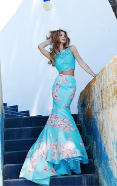 Style 32073 Rich floral print taffeta spans this fitted mermaid skirt and is a perfect match for our lace cropped top.