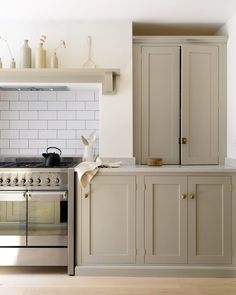 Lovely countertop cupboards make the most of these awkward alcoves in the beautifully simple Barnsbury Islington Kitchen #deVOLKitchens
