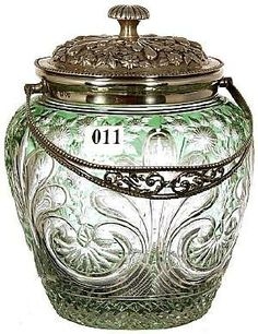 "Stevens & Williams 7"" green cut-to-clear biscuit jar, with engraved floral and rococo design."