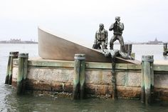 Merchant Mariners Memorial.  Westside of Battery park  Dramatic sculpture designed by artist Marisol, was based on a true event during World War II, in which a Nazi U-boat attacked an American merchant marine vessel. While the marines held on to their sinking vessel, the Nazis photographed the victims, then left.    more at http://www.scoutingny.com/?p=615
