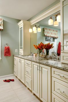 Pamela Harvey Interiors created a fun, cool bathroom space for two busy teenage girls. They added two sinks and two separate areas for storage, including outlets inside the cabinets to house and hide blow dryers, electric toothbrushes and more!