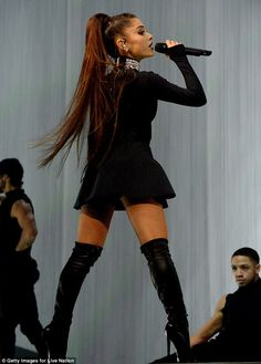 Beauty in black! Ariana changed wardrobes into a plush black mini dress with rhinestone encrusted collar and black thigh high boots