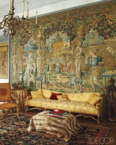 17th-century Flemish tapestry in the drawing room of Château de Fleury, Charles de Ganay's home in Fleury-en-Bière, France; the sofa and armchair are Regency style.