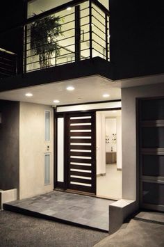 The slatted windows on this pivot door allow in lots of natural light! Find out more about pivot doors or design your own at https://pivotdoorcompany.com/Exterior-Doors/.