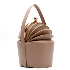 Gabriela Hearst Ella Bag. The bag have stolen our hearts with their beautifully-shaped pleats that opens up like an accordion once you undo the clasp. Finished with a top handle, the bag has a roomy enough body that's good for most of your essentials.