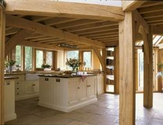 Painted timber kitchen with oak frame and stone floor in Riverside house (photo: Spike Powell)
