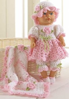 Original Crochet Pattern by: Maggie Weldon Skill Level: Easy Size: Fits 15″ doll; Blanket is 13″ square. Materials: Yarn Needle; Sport Weight Yarn; White (W): 2 ¾ oz, 198 yd (77 g, 178 m); Pink (P): 2                                                                                                                                                     More
