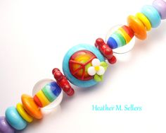 Sunshine and rainbows by Heather Sellers. Rainbow inspired lampwork glass beads. #rainbow #lampwork #glassbeads