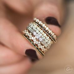 Stackable diamond bands from A.JAFFE, including rose gold, yellow gold and black diamonds.