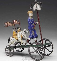 PATRIOTIC BELL TOY. This toy is part of a patriotic bell tin toy series manufactured by Althof Bergmann & Co. Man
