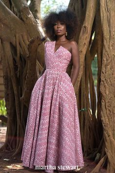 An asymmetrical bodice and batik style print set this wedding guest dress apart from the rest. #weddingideas #wedding #marthstewartwedding #weddingplanning #weddingchecklist African Inspired Fashion, Latest African Fashion Dresses, African Print Dresses, African Print Fashion, African Dress, Ankara Fashion, Africa Fashion, Tribal Fashion, African Prints