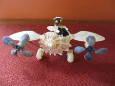 Vintage Shell Art Airplane with Fighter Pilot Funky and Kitsch 1970s. $25.00, via Etsy.