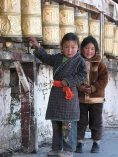 Prayer Wheels . Tibet* Arielle Gabriel writes about miracles and travel in The Goddess of Mercy & The Dept of Miracles also free China toys and paper dolls at The China Adventures of Arielle Gabriel *