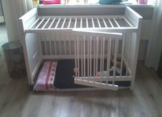 They turned the crib upside down & left the bottom open (using mattress) - then cut one side in half & hinged for a door